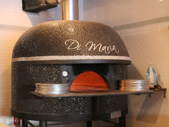 <p>The custom Stefano Ferrara wood-fired oven at Tufino Pizzeria Napoletana, which opened at 36-08 Ditmars Blvd on Tuesday, Dec. 18, 2012. The brick oven was hand built in Naples, Italy.</p>