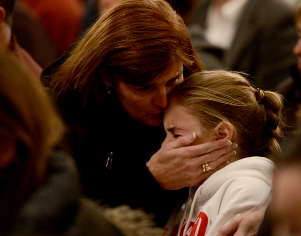 <p>Mourners gather inside the St. Rose of Lima Roman Catholic Church at a vigil service for victims of the Sandy Hook School shooting December 14, 2012 in Newtown, Connecticut.</p>