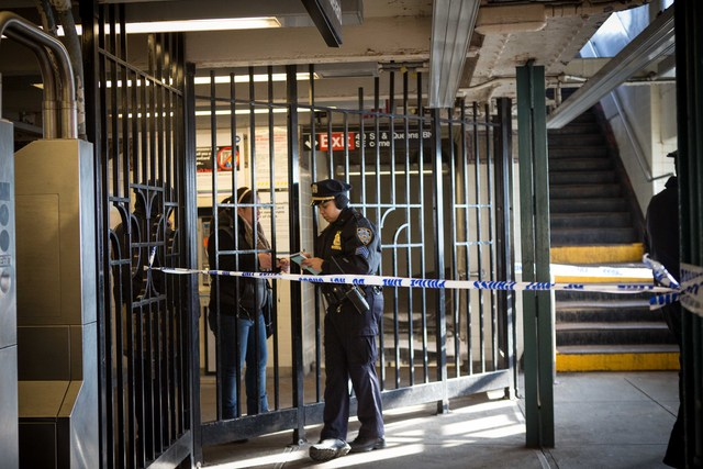 <p>A woman speaks with a police officer at 40th Street Station in Sunnyside Friday morning, Dec. 28, 2012.</p>