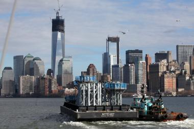 The World Trade Center's crowning spire made it's way to New York via a barge in the Hudson River Tuesday. Officials expect the first pieces of the heavy spire to be hoisted atop One World Trade Center Wednesday morning.