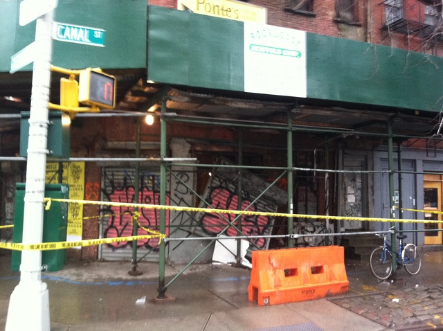 <p>Police tape roped off the sidewalk near 502 Canal St. after a partial collapse Jan. 16, 2013.</p>