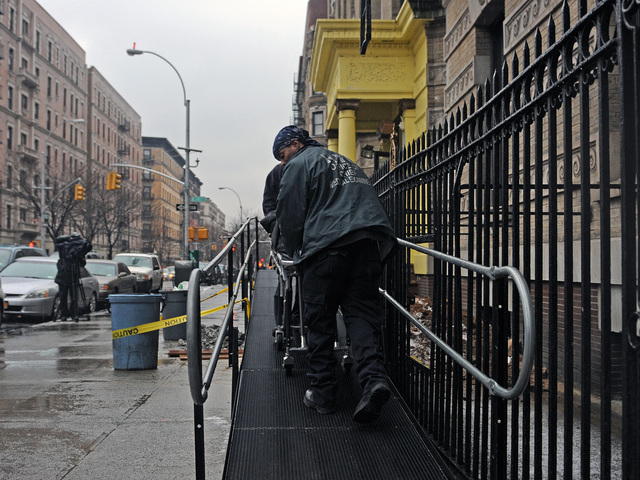 <p>Police removed a man&#39;s body from 87 Hamilton Place in Harlem Jan. 28, 2013.</p>