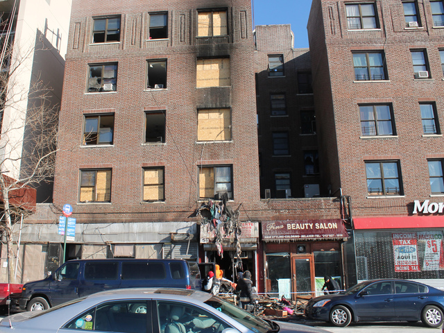 <p>Workers began clearing out debris at 2440 Amsterdam Ave. on Jan. 24, 2013.</p>