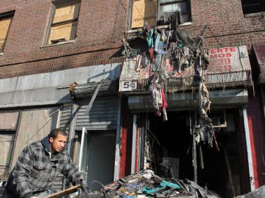 A fire raced through an Amsterdam Avenue apartment building in Washington Heights late Wednesday Jan. 23, 2013.