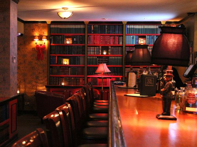 <p>True to its name, Bar and Book&#39;s walls are lined with books accompanied by reading chairs, like a dimly lit study.</p>