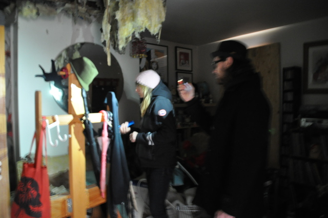 <p>Tara McPherson and Sean Leonard combed through the wreckage of their apartment on 173 Bedford Ave.</p>