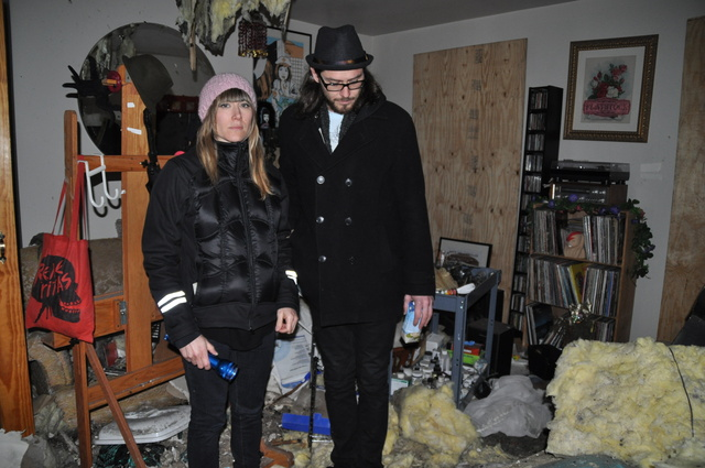 <p>Tara McPherson and her boyfriend Sean Leonard stood in the rubble of their apartment on 173 Bedford Ave., which suffered a fire Jan. 22.</p>