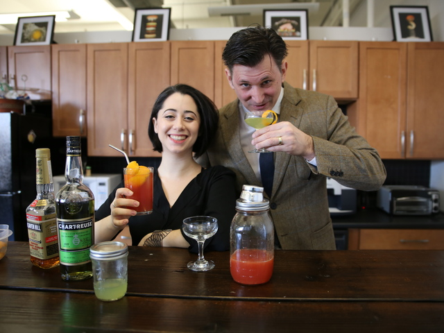<p>Amy Litt and AJ Lawrence enjoy cocktails in the bar at their DUMBO office space.</p>