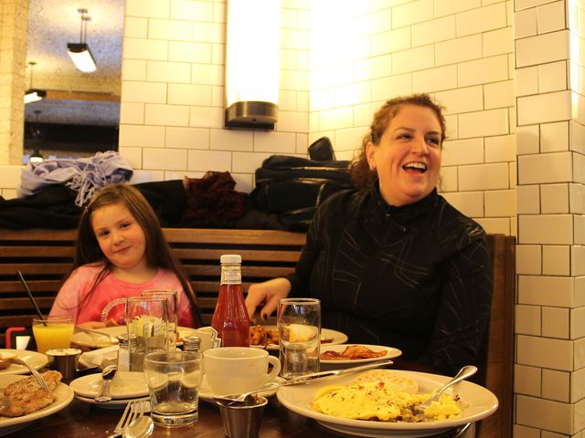 <p>Monica Susel and her daughter Sasha enjoy breakfast at The Smith.&nbsp;</p>