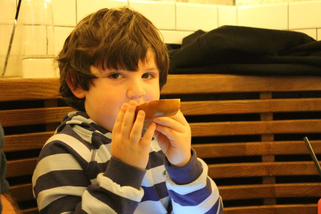 <p>Zach Susel, 4, enjoys a bagel at The Smith.&nbsp;</p>