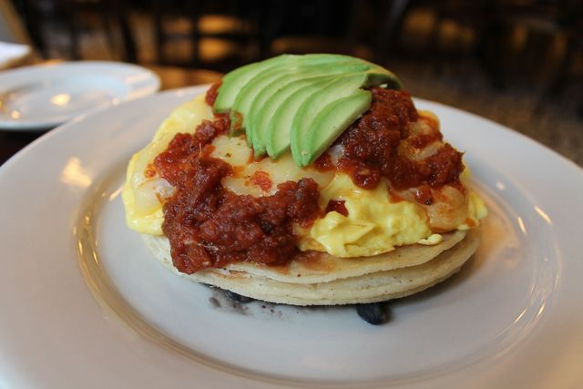 <p>The Ranchero Scramble: chipotle salsa, black beans, tortillas, cheddar and avocado.</p>