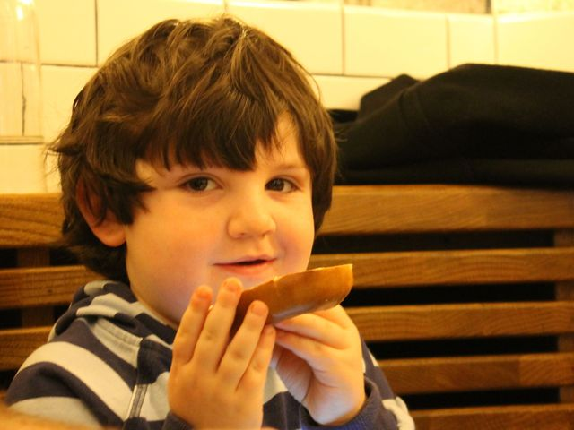 <p>Zach Susel, 4, enjoys a bagel, which was added to The Smith&#39;s menu especially for the Upper West Side.</p>