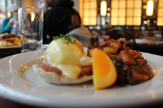 <p>The Smith offers a classic eggs benedict with a side of fries.&nbsp;</p>