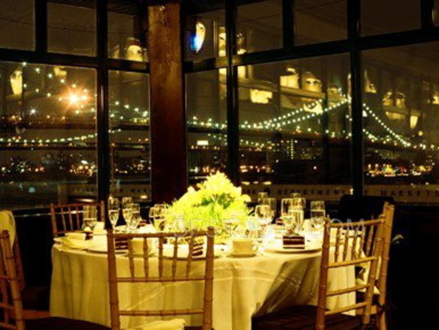 <p>The interior of&nbsp; popular Seaport catering hall Bridgewaters, before being shuttered during Hurricane Sandy. Brides say they loved the views of the Brooklyn Bridge.</p>