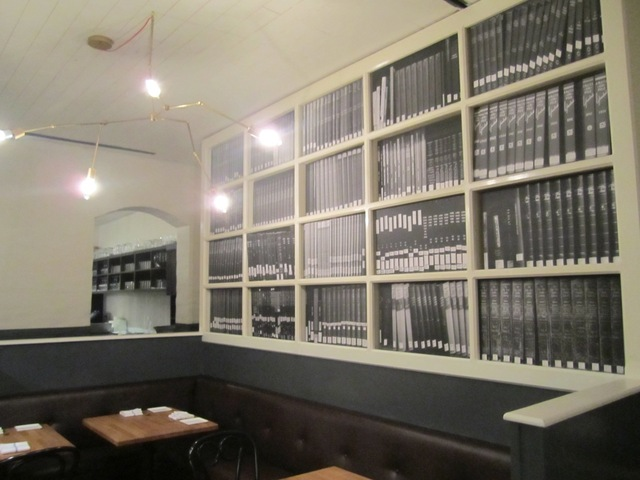 <p>The West 10th Street restaurant Louro&nbsp;has painted trompe l&#39;oeil bookshelves on two of its walls.</p>