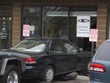 A car crashed into a Staten Island Business at 18 Bradley Avenue Monday afternoon, Jan. 21, 2013.