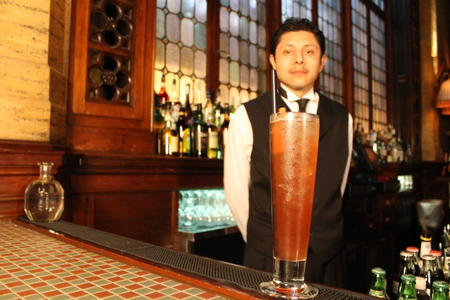 <p>Campbell Apartment bartender Raul Ortiz serves up a Centennial Punch.</p>