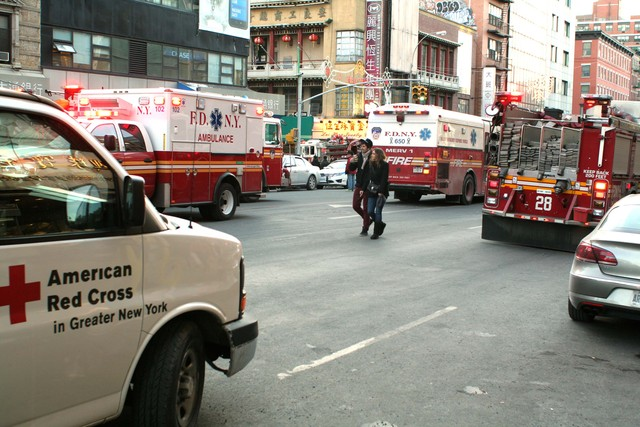 <p>Emergency vehicles respond to a large fire, which broke out at 75 Mott St. on Jan. 27, 2013.&nbsp;</p>