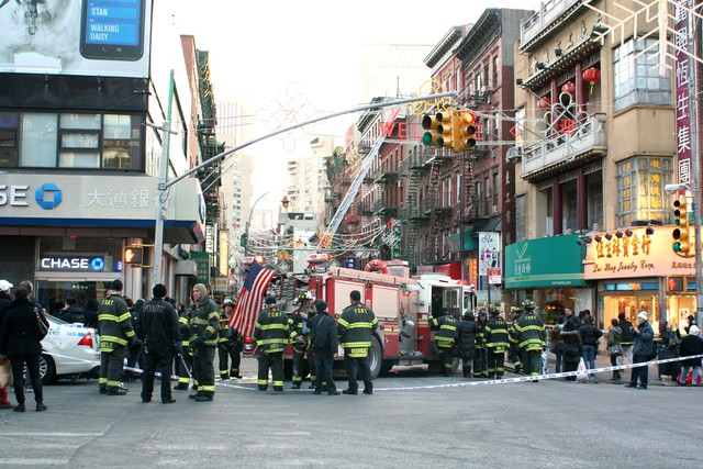 <p>Emergency vehicles respond to a large fire, which broke out at 75 Mott St. on Jan. 27, 2013.</p>