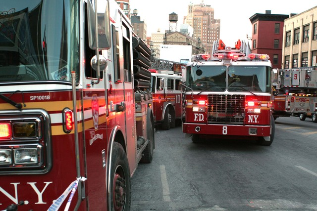 <p>Fire trucks gather on Canal Street near the scene of a large fire at 75 Mott St. on Jan. 27, 2013.</p>