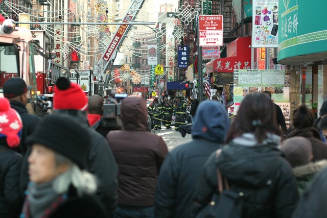 <p>Crowds gather at the scene of a large fire at 75 Mott St. on Jan. 27, 2013.</p>