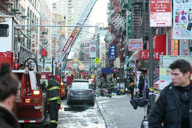<p>Firefighters work on a large fire at 75 Mott St. on Jan. 27, 2013.</p>