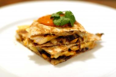 These smoky quesadillas are perfect for a   Super Bowl snack or paired with a zesty salad.