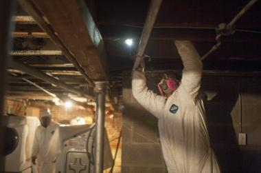 Workers remove mold from a Rockaways house damaged by Hurricane Sandy Jan. 12, 2013.