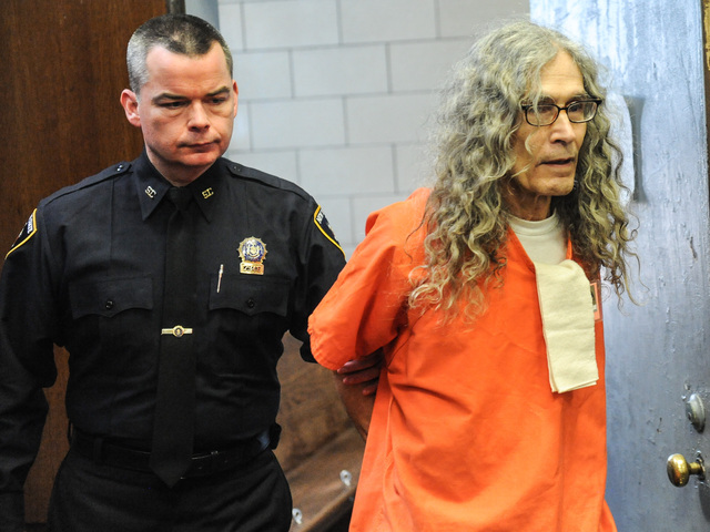 <p>Convicted serial killer Rodney Alcala is led into court for sentencing in Manhattan.</p>