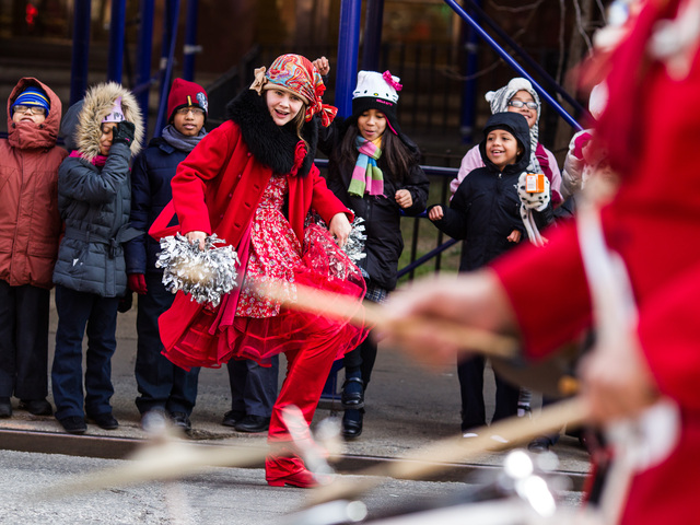 <p>A dancer entertains children at the Annual Three Kings Day Parade in East Harlem on Jan. 4, 2013.</p>