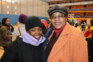 "Almost 2,000 people gathered at the Harlem Armory on Monday Jan. 21, 2013 to watch President Obama's second inauguartion and complete works of service in honor of Martin Luther King Jr. ""It's an amazing confluence of history to have President Obama's inauguration and Dr. King's holiday on the same day,"" said  Seth Andrew , superinetendent and founder of the charter school  Democracy Prep , which sponsored the celebration."