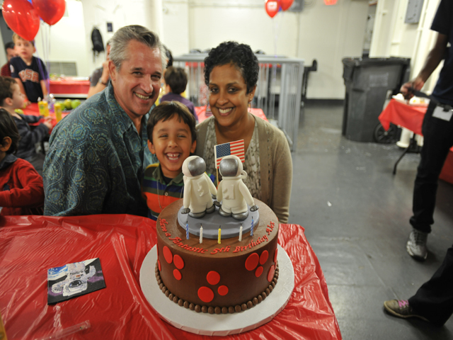 <p>Ed Hartzog poses with Nalika Nanayakkara, his wife, and their 5-year-old son at his birthday party.</p>