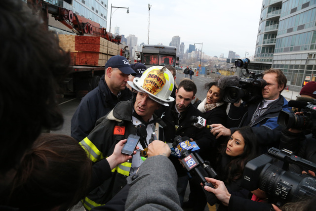 <p>FDNY Deputy Chief Mark Ferran spoke to reporters about the crane collapse at 46-10 Center Boulevard Jan. 9, 2013.</p>