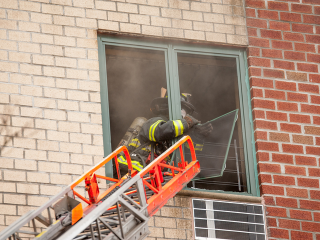 <p>Firemen tackle the fire at 580 Sutter Avenue on Jan. 1, 2013.</p>