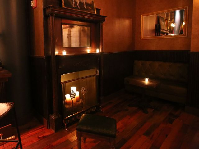 <p>The fireplace at the Flatiron Room is filled with candles for warmth and light.</p>