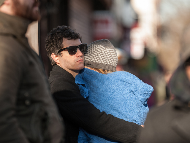 <p>Joseph Grillo, who lost his top-floor apartment in the building at 177 Bedford Ave., hugs his wife who escaped the fire on Tuesday Jan. 22, 2013.</p>