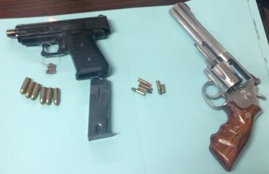A defaced and loaded Bryco Jennings 9mm semiautomatic pistol and a Smith & Wesson revolver, loaded with five live rounds and a spent shell casing, was found in the suspect's backpack, officials say.