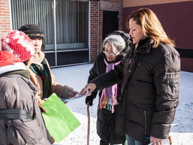 <p>Councilwoman Melissa Mark-Viverito hands out fliers about the rash of muggings in and around Franklin Plaza in the East Harlem neighborhood, on Jan. 26, 2013.</p>