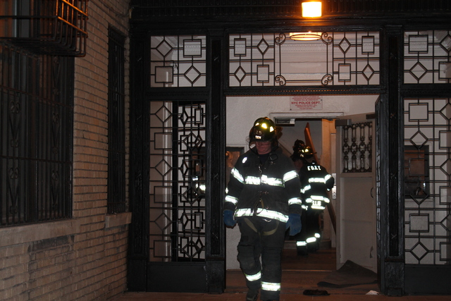 <p>Firefighters leaving the building at 1890 Adam Clayton Powell Blvd. where the bathroom of a fourth floor building collapsed.</p>