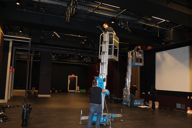 <p>A worker preps one of My Image Studio&#39;s theater spaces.</p>