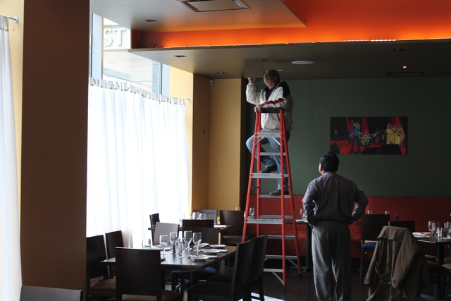 <p>A worker does some final touches on the restaurant Harvist.</p>