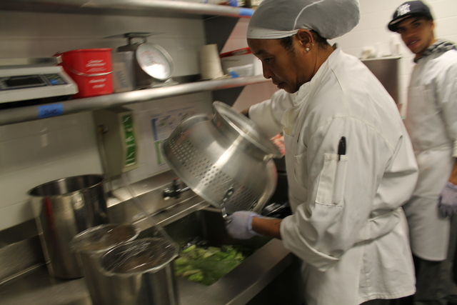<p>A cook preps greens at Harvist.</p>