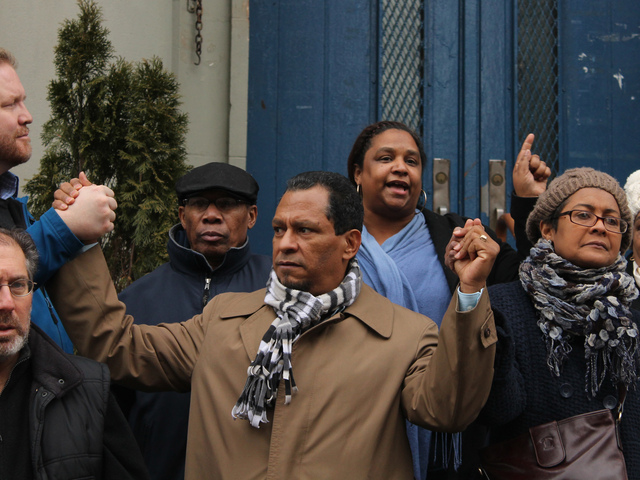 <p>Luis Tejada, who spoke at a rally against the school closing, held hands to show the community&#39;s united spirit.</p>