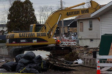 The city has demolished the first homes on Staten Island that were damaged by Sandy on Monday.