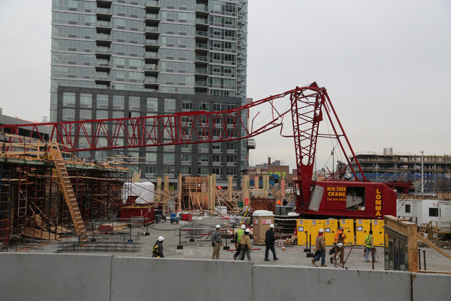 <p>The 170-foot boom of a crane collapsed at 46-10 Center Boulevard Jan. 9, 2013.</p>