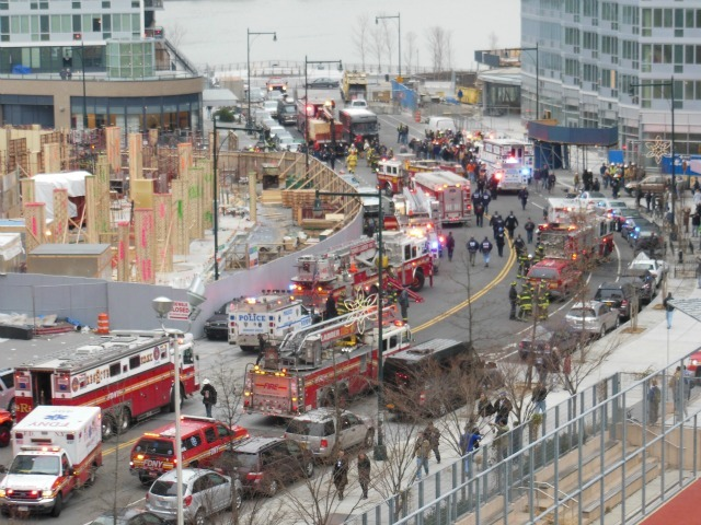 <p>Emergency vehicles flooded 46th Avenue and Center Boulevard in the wake of a crane collapse Jan. 9, 2013.</p>