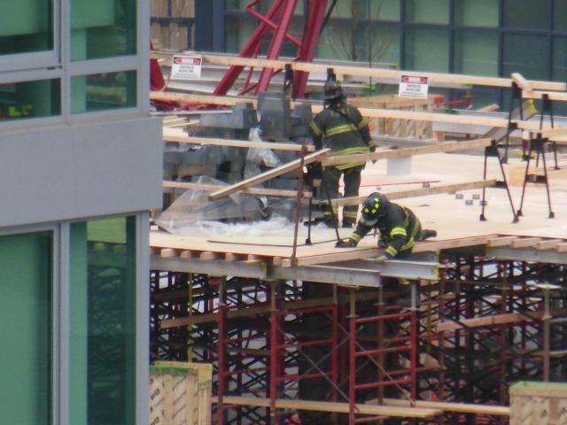 <p>Firefighters at the scene of a crane collapse in Long Island City Jan. 9, 2013.</p>