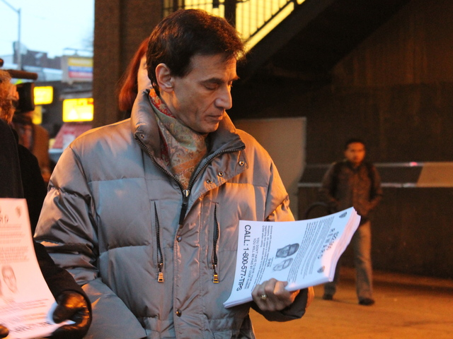 <p>Danyal Lawson hands out police fliers at the 40<sup>th</sup> Street-Lowery Street station in Sunnyside on Jan. 29, 2013. His husband, Lou Rispoli, was fatally beaten on a nearby street in October, and police are still looking for the suspects involved.</p>
