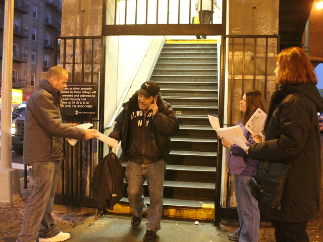 <p>Family and friends of Lou Rispoli, a gay activist and longtime Queens resident who was fatally beaten on a Sunnyside street in October, hand out police fliers at the 40th Street-Lowery Street station in Sunnyside on Jan. 29, 2013.</p>