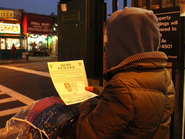 <p>A woman reads a police flier at the 40th Street-Lowery Street station in Sunnyside on Jan. 29, 2013. The NYPD released sketches of two suspects wanted in connection with the murder of Lou Rispoli, a longtime Sunnyside resident who was beaten to death in October of 2012.</p>